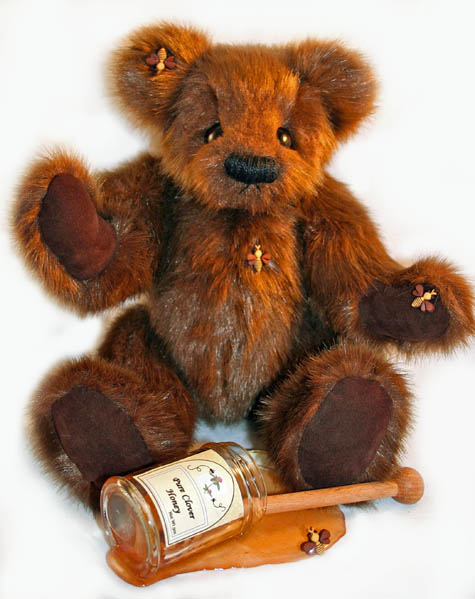 handmade teddy bear with honey jar and bees